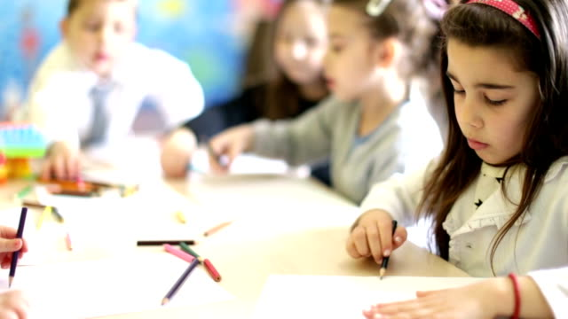 Cute girl drawing in the classroom video