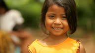 Cute girl from Cambodia smiling happily video