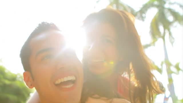 Cute girl hugs boyfriend from behind video