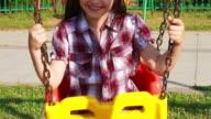 Cute girl on a swing video