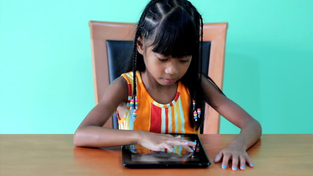 Cute Girl Playing Games On Digital Tablet video