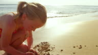 Cute girl plays in the sand video