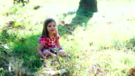 Cute Girl Sits in the Grass video