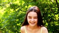 Cute girl smiling at camera video