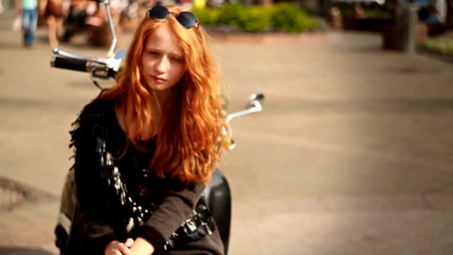 Cute girl with red hair and the old motorbike video