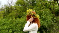 Cute girl with wreath of flowers. video