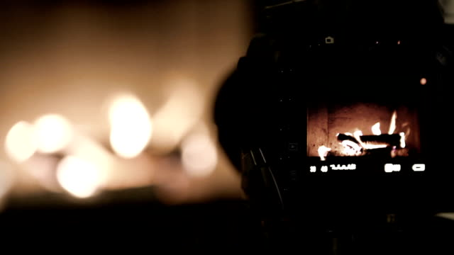 Cute home fireplace video shooting process with DSLR camera video