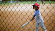 Cute kid batting during baseball practice video