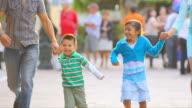 Cute kids running through city video