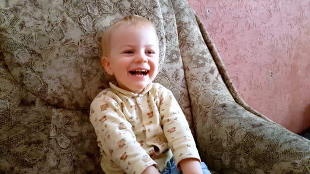 Cute laughing child watching cartoons video