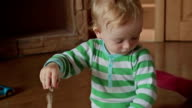 A cute little blond boy play with kinetic sand video
