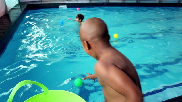 Cute little boys playing in the pool video