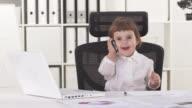 HD: Cute Little Business Girl Talking On Phone video