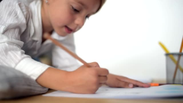 Cute little girl drawing at the table video