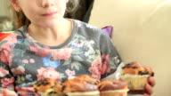 Cute little girl eating cupcake video