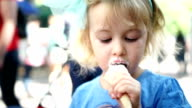 Cute Little Girl Eating Ice Cream Cone video