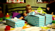 Cute Little Kid Opening Christmas Gifts. video