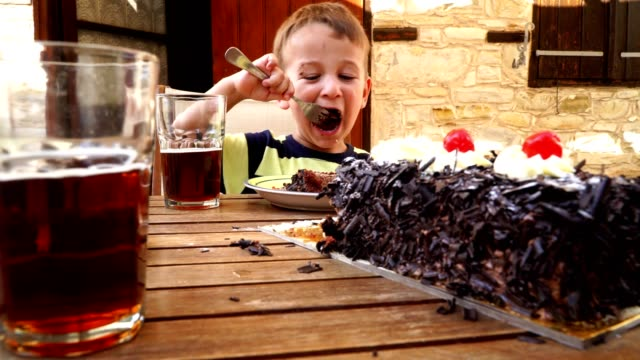 Cute Little Kids Eating Black Forest Cake video