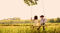 SLO MO Cute loving kids swinging in the nature video