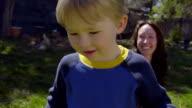 Cute male child blows bubbles video