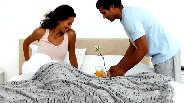 Cute man bringing the breakfast to his girlfriend video
