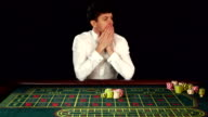 Cute man have lost in a casino, black, slow motion video