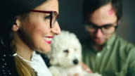 Cute nerd family with their white poodle video