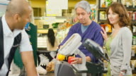 Cute older couple at checkout line video