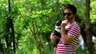 Cute pup of a Jack Russell Terrier playing around with a young gourgeous man video