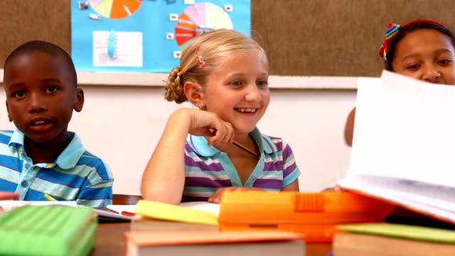 Cute pupils talking in class video