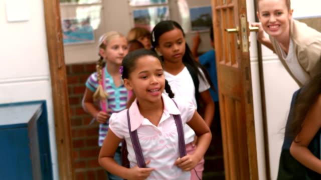 Cute pupils walking into classroom video