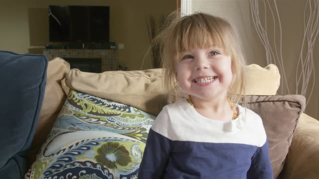 Cute toddler girl smiling and making faces video