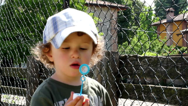 Cute toddler playing with bubble soap video