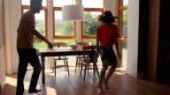 Cute young couple dancing together video