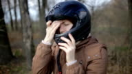 Cute young red-haired woman wears a motorcycle helmet video