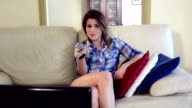cute young woman watching tv video