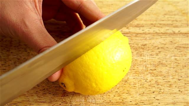 Cutting a lemon in half video