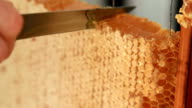 cutting a piece of scented honeycomb, concept of healthy eating video