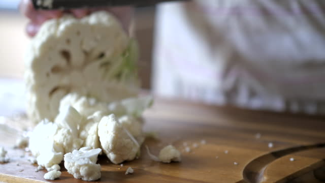 cutting cauliflower in home video