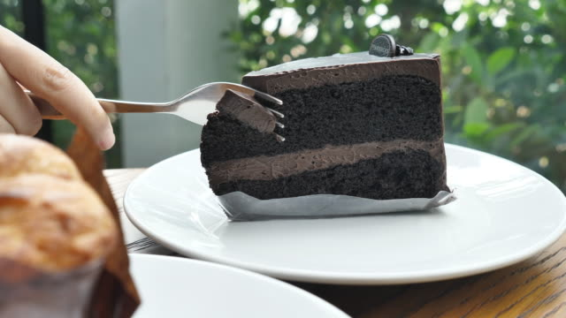 Cutting chocolate cake, Slow motion video