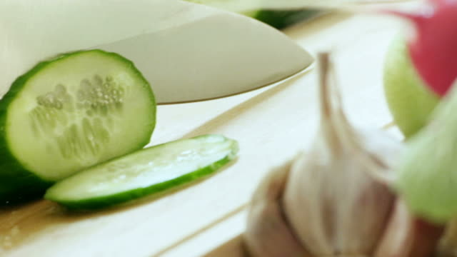Cutting cucumber in kitchen. video