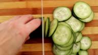 Cutting cucumber in kitchen. video