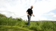 Cutting grass with a scythe HD Real Time video