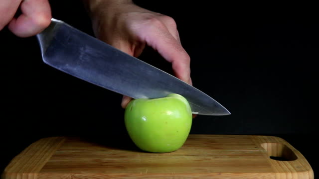 Cutting green apple video