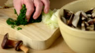 cutting herbs for a meal of Bay Bolete mushroom video
