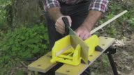 Cutting mitered cuts using saw and mitre box video