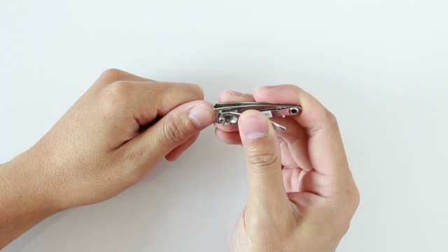 Cutting nails with nail clippers video