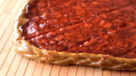 Cutting of a strawberry pie using a steel knife video