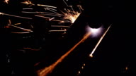 Cutting of metal. Sparks fly from laser video