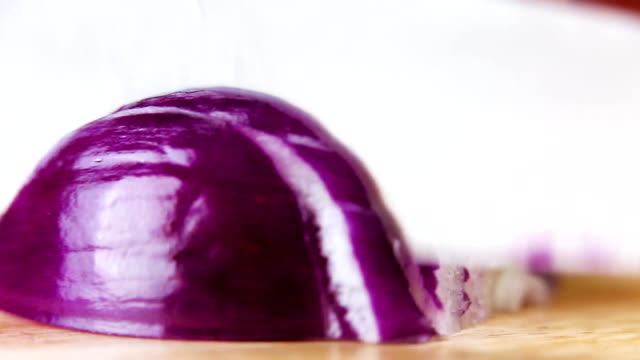 cutting onions with knife, closeup video